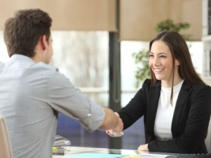 man and woman shaking hand - business